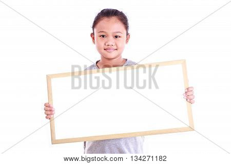 Portrait Of Little Asian Child Show The Black Board Isolated Isolated On White