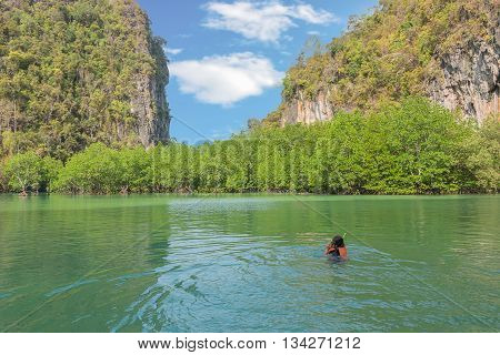 Asia Young lady snorkeling in Tropical beach scenery Andaman sea View of koh hong island krabiThailand