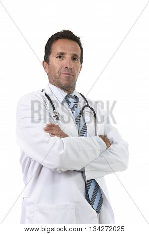 40s attractive and happy male medicine doctor with stethoscope wearing medical gown standing proud smiling with folded arms in corporate portrait isolated on white background