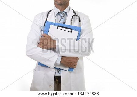 corporate portrait of confident 40s attractive male medicine doctor with stethoscope on shoulders and medical gown holding clipboard isolated on white background faceless anonymous crop
