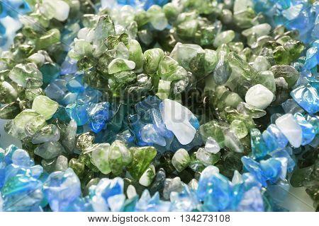 Pieces of nephrite and aquamarine closeup as a background
