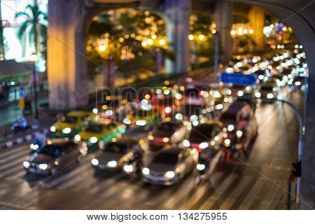 Abstract blurred traffic jam on road in city with bokeh light background.