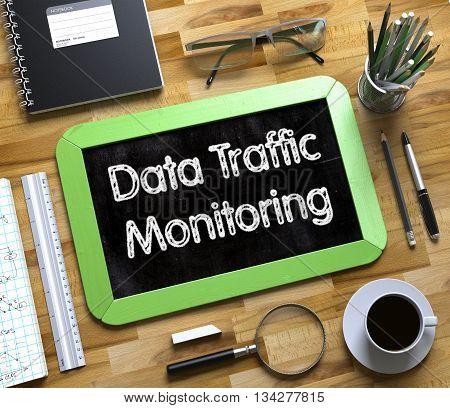 Data Traffic Monitoring Handwritten on Small Chalkboard. Small Chalkboard with Data Traffic Monitoring. 3d Rendering.