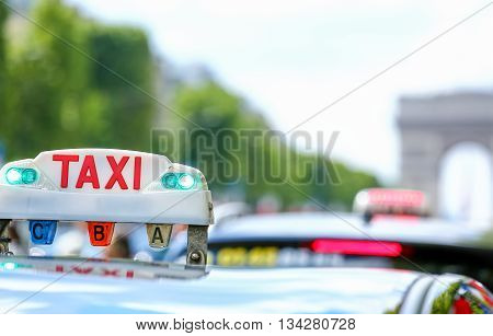 closeup on Parisian taxi in the city