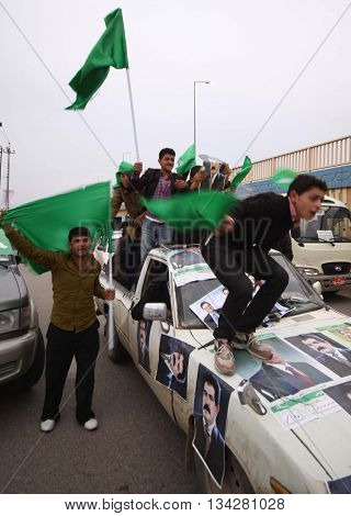 ARBİL,IRAQ-MARCH 5, 2010: Election campaign convoy during 2010 elections, in Kurdistan, Iraq.