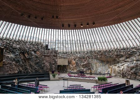 HELSINKI, FINLAND - circa MARCH 2016: The interior of the church in the rock (Temppeliaukio) in Helsinki, Finland. The rock church is a popular sightseeing destination for tourists in Helsinki.