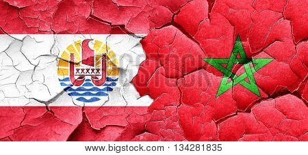french polynesia flag with Morocco flag on a grunge cracked wall