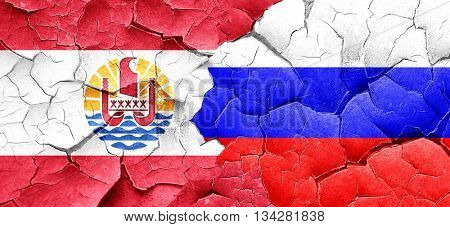 french polynesia flag with Russia flag on a grunge cracked wall