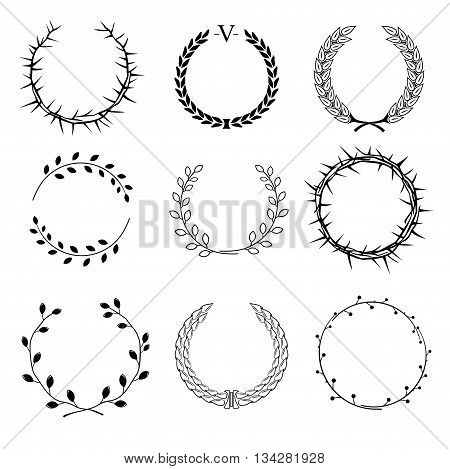 Set of different circular wreaths of different plants - thorns, laurel, of ears and seeds of different branches with leaves on a white background in vector graphics
