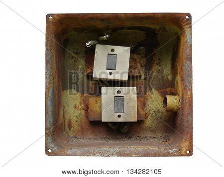Two electrical switch in the rusty metal box isolated on white.