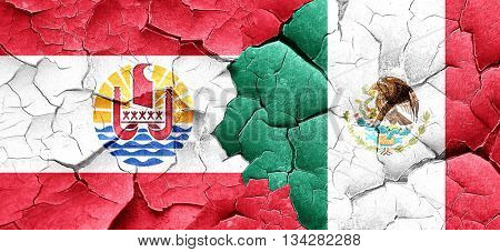 french polynesia flag with Mexico flag on a grunge cracked wall