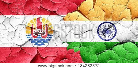 french polynesia flag with India flag on a grunge cracked wall