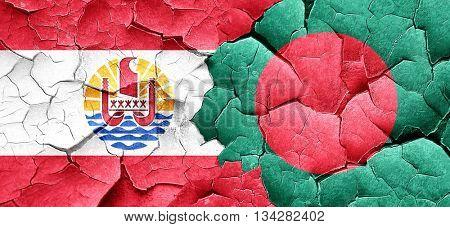 french polynesia flag with Bangladesh flag on a grunge cracked w