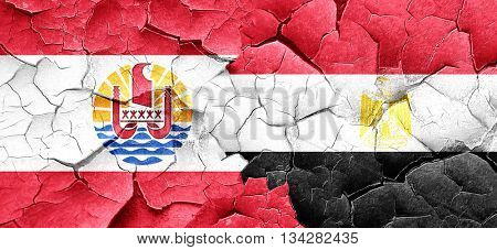 french polynesia flag with egypt flag on a grunge cracked wall