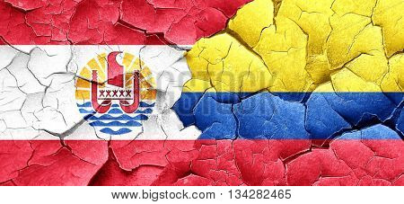 french polynesia flag with Colombia flag on a grunge cracked wal