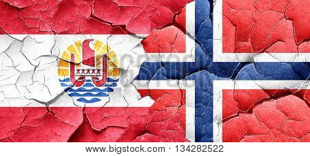 french polynesia flag with Norway flag on a grunge cracked wall