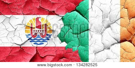 french polynesia flag with Ireland flag on a grunge cracked wall