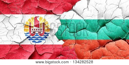 french polynesia flag with Bulgaria flag on a grunge cracked wal