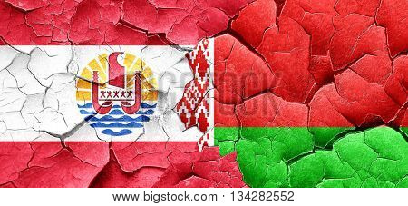 french polynesia flag with Belarus flag on a grunge cracked wall