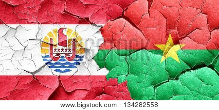 french polynesia flag with Burkina Faso flag on a grunge cracked