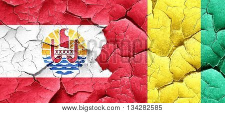 french polynesia flag with Guinea flag on a grunge cracked wall