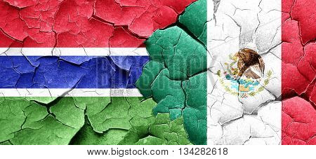 Gambia flag with Mexico flag on a grunge cracked wall
