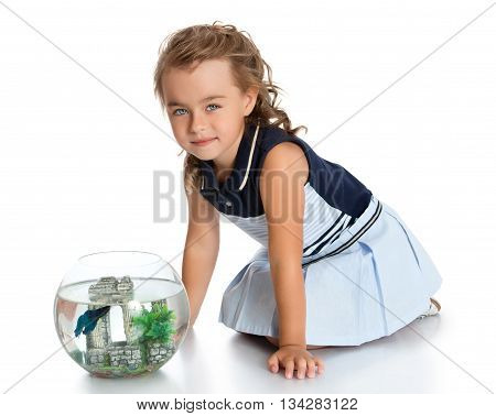 Beautiful little girl near the aquarium looking at the fish-Isolated on white background
