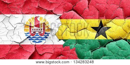 french polynesia flag with Ghana flag on a grunge cracked wall