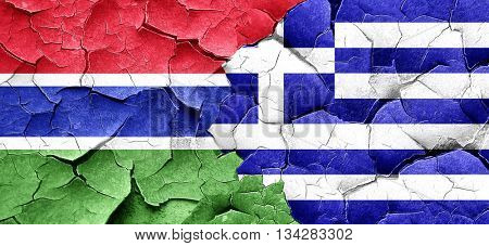 Gambia flag with Greece flag on a grunge cracked wall