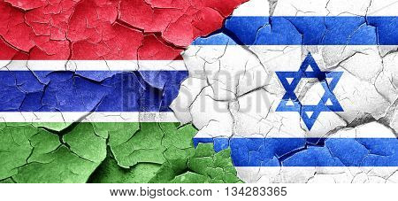 Gambia flag with Israel flag on a grunge cracked wall