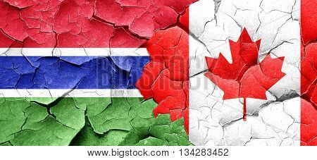 Gambia flag with Canada flag on a grunge cracked wall