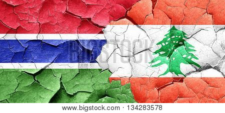 Gambia flag with Lebanon flag on a grunge cracked wall