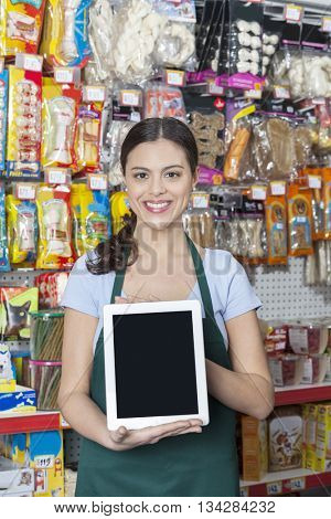 Saleswoman Showing Digital Tablet With Blank Screen In Pet Store