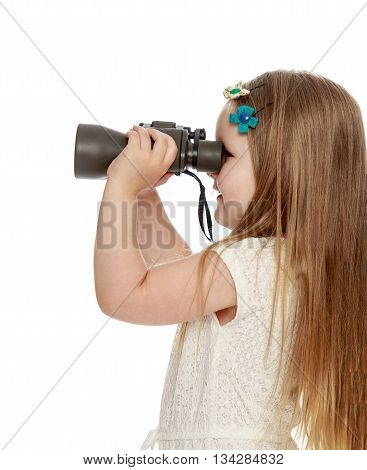 Cute little long-haired girl turned sideways to the camera looking through binoculars . close-up - Isolated on white background