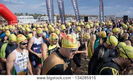 VALENCIA, SPAIN - JUNE 4, 2016: Triathletes get set for the 1500 meter swim portion of the Santander Maritim Triathlon. The swim is followed by a 40 kilometer bike ride and then a 10 kilometer run.