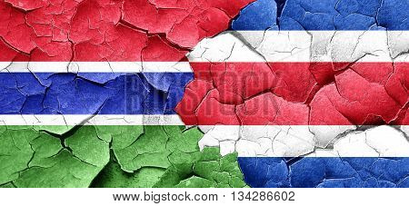 Gambia flag with Costa Rica flag on a grunge cracked wall