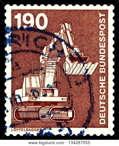 STAVROPOL RUSSIA - APRIL 04 2016: a stamp printed by Germany shows excavator series Industry and Technology circa 1975