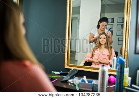 Stylist applying make up for bride on the wedding day