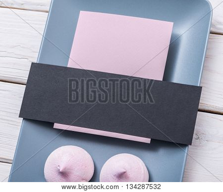 Mockup of a paper tags with kisses on a blue dish