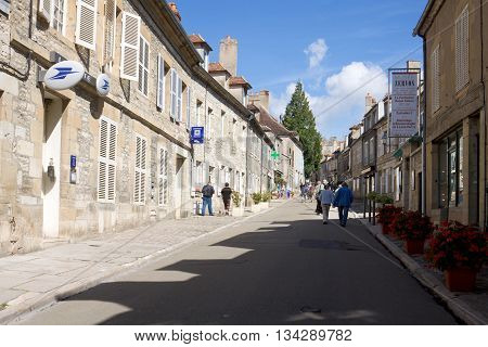VEZELAY FRANCE - SEPTEMBER 13 2010: The main street in Vezelay Abbey. Vezelay is a commune in Burgundy. It is a defendable hill town famous for Vezelay Abbey. The town and the Romanesque Basilica of St Magdalene are designated UNESCO World Heritage sites.