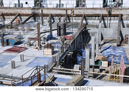 MOSCOW, RUSSIA - APRIL 11, 2015: Construction of a reinforced concrete foundation of a modern building