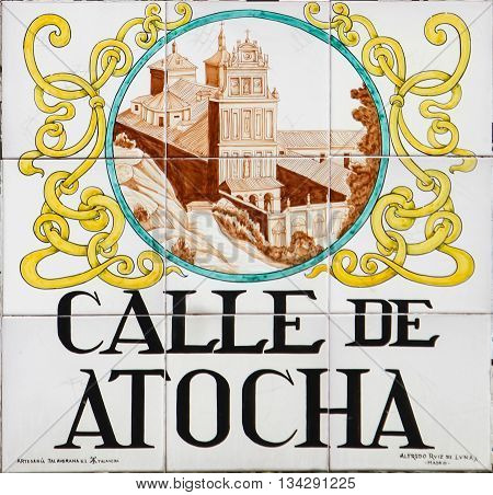 MADRID. SPAIN - MARCH 14. 2016 : Closeup of the street sign. Street signs in Madrid are hand-painted ceramic tiles typically composed within 9 or 12 tiles. They depict the name of the alley or street.