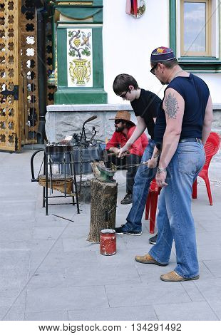 MOSCOW, RUSSIA - MAY 7, 2016: Lesson of blacksmithing skill