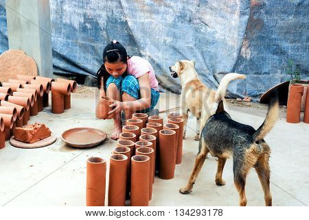 BAC Ninh, Vietnam, December 22, 2015 girls, rural, Bac Ninh province, working, producing traditional pottery