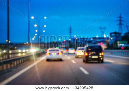 Illuminated road car shot with blurred focus