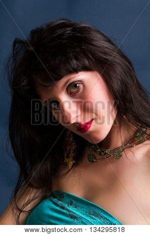 beautiful young brunette portrait shot in studio on a dark background