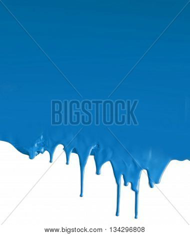 Dripping blue paint flow on white background