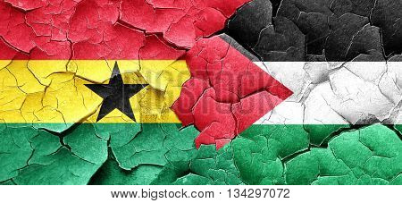 Ghana flag with Palestine flag on a grunge cracked wall