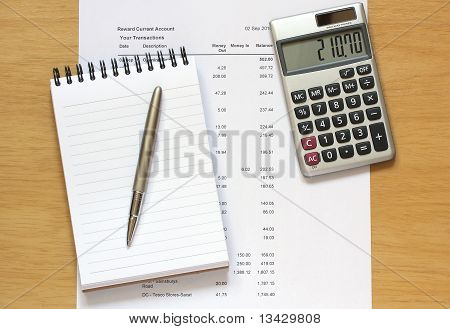 Calculator Notebook Pen And Financial Figures