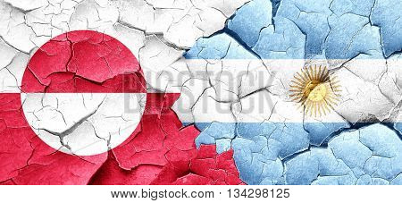 greenland flag with Argentine flag on a grunge cracked wall